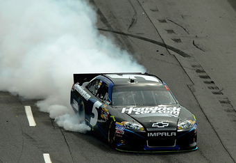 MARTINSVILLE, VA - APRIL 01:  Kasey Kahne, driver of the #5 HendrickCars.com Chevrolet, drives to pit lane with a blown engine during the NASCAR Sprint Cup Series Goody's Fast Relief 500 at Martinsville Speedway on April 1, 2012 in Martinsville, Virginia.