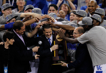 NEW ORLEANS, LA - APRIL 02:  Head coach John Calipari and Kentucky President Eli Capilouto hold the trophy after the Wildcats defeat the Kansas Jayhawks 67-59 in the National Championship Game of the 2012 NCAA Division I Men's Basketball Tournament at the
