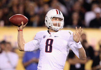 TEMPE, AZ - NOVEMBER 19:  Quarterback Nick Foles #8 of the Arizona Wildcats throws a pass during the college football game against the Arizona State Sun Devils at Sun Devil Stadium on November 19, 2011 in Tempe, Arizona. The Wildcats defeated the Sun Devi