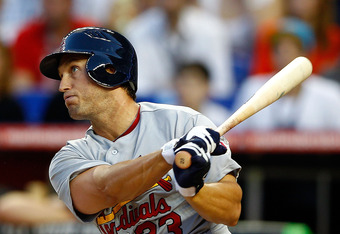 MIAMI, FL - APRIL 04: David Freese #23 of the St. Louis Cardinals hits the first RBI during Opening Day against the Miami Marlins at Marlins Park on April 4, 2012 in Miami, Florida.  (Photo by Mike Ehrmann/Getty Images)