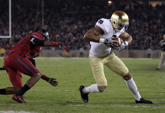 STANFORD, CA - NOVEMBER 26:  Michael Floyd #3 of the Notre Dame Fighting Irish gets past Wayne Lyons #2 of the Stanford Cardinal to score a touchdown at Stanford Stadium on November 26, 2011 in Stanford, California.  (Photo by Ezra Shaw/Getty Images)