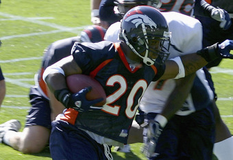 ENGLEWOOD,CO  - JULY 29:  Running back Maurice Clarett #20 of the Denver Broncos runs the ball on the first day of Training Camp at the Broncos Training Facility on July 29, 2005 in Englewood, Colorado. (Photo by Doug Pensinger/Getty Images)
