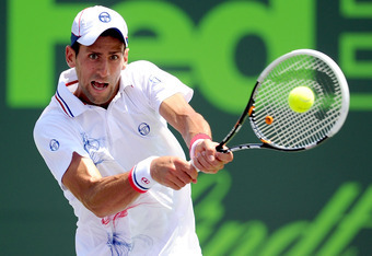 KEY BISCAYNE, FL - APRIL 01:  Novak Djokovic of Serbia returns a shot to Andy Murray of Great Britain during the final of the Sony Ericsson Open at the Crandon Park Tennis Center on April 1, 2012 in Key Biscayne, Florida.  (Photo by Michael Regan/Getty Im