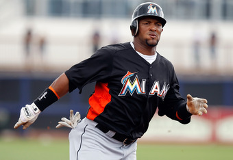 PORT CHARLOTTE, FL - MARCH 25:  Outfielder Emilio Bonifacio #1 of the Miami Marlins runs for a triple in the first inning against the Tampa Bay Rays during a Grapefruit League Spring Training Game at the Charlotte Sports Complex on March 25, 2012 in Port