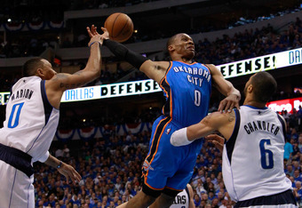 DALLAS, TX - MAY 25:  Russell Westbrook #0 of the Oklahoma City Thunder goes up for a dunk as Shawn Marion #0 of the Dallas Mavericks attempts to block the dunk as Westbrook crashes into Tyson Chandler #6 of the Mavericks in Game Five of the Western Confe
