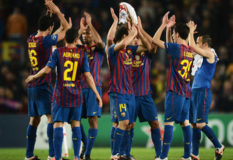 BARCELONA, SPAIN - APRIL 03: FC Barcelona players celebrate at the end of the Champions League quarter-final second leg match between FC Barcelona and AC Milan at the Camp Nou stadium on April 3, 2012 in Barcelona, Spain.  (Photo by Jasper Juinen/Getty Im