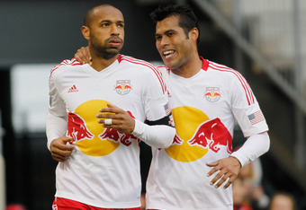 HARRISON, NJ - MARCH 31:  Thierry Henry #14 of the New York Red Bulls celebrates his frist half goal with teammate Wilman Conde #2 against the Montreal Impact at Red Bull Arena on March 31, 2012 in Harrison, New Jersey. The Red Bulls defeated the Impact 5