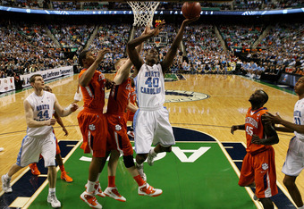 GREENSBORO, NC - MARCH 12:  Harrison Barnes #40 of the North Carolina Tar Heels shoots against Tanner Smith #5 of the Clemson Tigers during the first half in the semifinals of the 2011 ACC men's basketball tournament at the Greensboro Coliseum on March 12