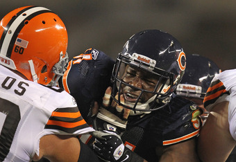 CHICAGO, IL - SEPTEMBER 01:  Amobi Okoye #91 of the Chicago Bears rushes against Steve Vallos #60 of the Cleveland Browns during a preseason game at Soldier Field on September 1, 2011 in Chicago, Illinois. The Bears defeated the Browns 24-14.  (Photo by J