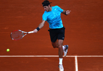 PARIS, FRANCE - MAY 27:  Juan Martin Del Potro of Argentina hits a forehand during the men's singles round three match between Juan Martin Del Potro of Argentina and Novak Djokovic of Serbia on day six of the French Open at Roland Garros on May 27, 2011 i