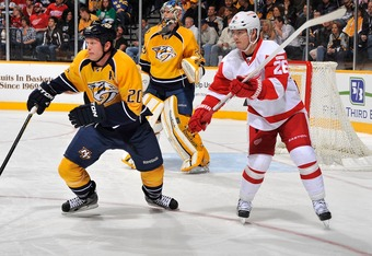 NASHVILLE, TN - MARCH 10:  Jiri Hudler #26 of the Detroit Red Wings skates against Ryan Suter #20 of the Nashville Predators at Bridgestone Arena on March 10, 2012 in Nashville, Tennessee.  (Photo by Frederick Breedon/Getty Images)