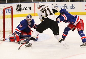 NEW YORK - DECEMBER 18:  Henrik Lundqvist #30 of the New York Rangers makes a save against Evgeni Malkin #71 of the Pittsburgh Penguins during their game at Madison Square Garden December 18, 2007 in New York, New York.  (Photo by Al Bello/Getty Images)