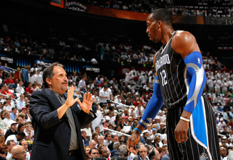 ATLANTA, GA - APRIL 28:  Head coach Stan Van Gundy converses with Dwight Howard #12 of the Orlando Magic during Game Six of the Eastern Conference Quarterfinals in the 2011 NBA Playoffs against the Atlanta Hawks at Philips Arena on April 28, 2011 in Atlan