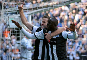 NEWCASTLE UPON TYNE, ENGLAND - APRIL 01:  Papiss Cisse of Newcastle United celebrates scoring the opening goal with team mate Yohan Cabaye (L) during the Barclays Premier League match between Newcastle United and Liverpool at Sports Direct Arena on April