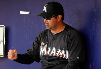 Ozzie Guillen holding an invisible cocktail.