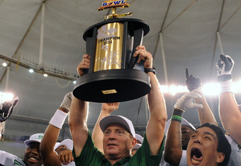 ST. PETERSBURG, FL - DECEMBER 20:  Coach Doc Holliday of the Marshall Thundering Herd holds the championship trophy after a 20 - 10 victory against the Florida International University Panthers December 20, 2011 in the Beef 'O' Brady's St. Petersburg Bowl