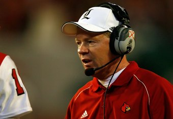 MIAMI GARDENS, FL - JANUARY 02:  Head coach Bobby Petrino of the Louisville Cardinals looks on against the Wake Forest Demon Deacons during the 2007 FedEx Orange Bowl at Dolphin Stadium on January 2, 2007 in Miami Gardens, Florida.  (Photo by Eliot J. Sch