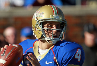 DALLAS, TX - DECEMBER 30:  G.J. Kinne #4 of the Tulsa Golden Hurricane throws against the Brigham Young Cougars during the Bell Helicopter Armed Forces Bowl at Gerald J. Ford Stadium on December 30, 2011 in Dallas, Texas.  (Photo by Ronald Martinez/Getty