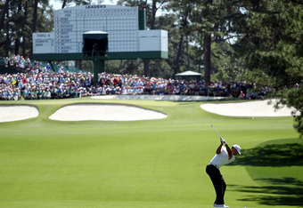 AUGUSTA, GA - APRIL 07: Tiger Woods of the United States hits his second shot on the seventh hole during the third round of the 2012 Masters Tournament at Augusta National Golf Club on April 7, 2012 in Augusta, Georgia.  (Photo by Jamie Squire/Getty Image