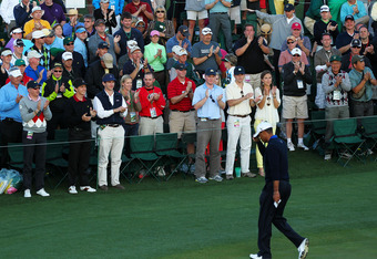 AUGUSTA, GA - APRIL 06:  Tiger Woods of the United States tips his hat after completing his second round of the 2012 Masters Tournament at Augusta National Golf Club on April 6, 2012 in Augusta, Georgia.  (Photo by Jamie Squire/Getty Images)