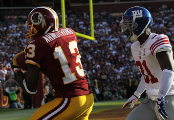 LANDOVER, MD - SEPTEMBER 11:  Anthony Armstrong #13 of the Washington Redskins makes a touchdowns pass reception against Aaron Ross #31 of the New York Giants at FedExField on September 11, 2011 in Landover, Maryland.  (Photo by Ronald Martinez/Getty Imag