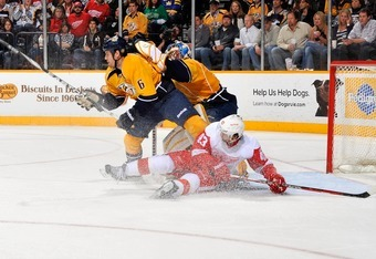 NASHVILLE, TN - MARCH 10:  Shea Weber #6 of the Nashville Predators defends Darren Helm #43 of the Detroit Red Wings at Bridgestone Arena on March 10, 2012 in Nashville, Tennessee.  (Photo by Frederick Breedon/Getty Images)