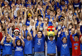 LAWRENCE, KS - DECEMBER 03: Kansas Jayhawks fans raise their arms during a free throw attempt by the opposing New Mexico State Aggies during the first half of the game on December 3, 2008 at Allen Fieldhouse in Lawrence, Kansas. (Photo by Jamie Squire/Get