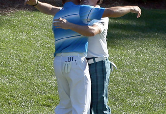 AUGUSTA, GA - APRIL 07:  Sergio Garcia (L) of Spain hug Rory McIlroy of Northern Ireland after they both made birdie on the 12th hole during the third round of the 2012 Masters Tournament at Augusta National Golf Club on April 7, 2012 in Augusta, Georgia.