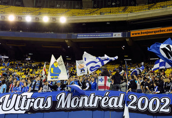 MONTREAL, CANADA - APRIL 7:  Montreal Impact fans during the MLS match against the Toronto FC at the Olympic Stadium on April 7, 2012 in Montreal, Quebec, Canada.  The Impact defeated the Toronto FC 2-1.  (Photo by Richard Wolowicz/Getty Images)