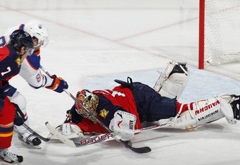 SUNRISE, FL - MARCH 23: Goaltender Jose Theodore #60 of the Florida Panthers dives in front of the crease to stop a shot by Sam Gagner # 89 the Edmonton Oilers on March 23, 2012 at the BankAtlantic Center in Sunrise, Florida. The Oilers defeated the Panth