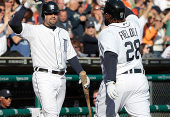 DETROIT, MI - APRIL 07: Prince Fielder #28 of the Detroit Tigers hits his second home run of the game in the fifth inning and is congratulated by teammate Alex Avila #13 during the game against the Boston Red Sox at Comerica Park on April 7, 2012 in Detro