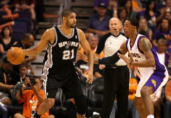 PHOENIX, AZ - MARCH 27:  Tim Duncan #21 of the San Antonio Spurs handles the ball during the NBA game against the Phoenix Suns at US Airways Center on March 27, 2012 in Phoenix, Arizona. The Spurs defeated the Suns 107-100. NOTE TO USER: User expressly ac