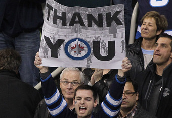 WINNIPEG, CANADA - APRIL 7: A Winnipeg Jets fans holds up a sign thanking the team for the season during a Winnipeg Jets game against the Tampa Bay Lightning in NHL action at the MTS Centre on April 7, 2012 in Winnipeg, Manitoba, Canada. (Photo by Mariann