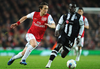 LONDON, ENGLAND - MARCH 12:  Tomas Rosicky of Arsenal and Cheik Ismael Tiote of Newcastle battle for the ball during the Barclays Premier League match between Arsenal and Newcastle United at Emirates Stadium on March 12, 2012 in London, England.  (Photo b