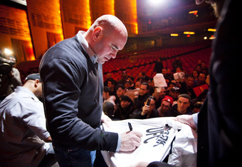 NEW YORK - MARCH 06:   UFC president Dana White signs autographs for fans after a press conference at Radio City Music Hall on March 06, 2012 in New York City.  UFC announced that their third event on the FOX network will take place on Saturday, May 5 fro