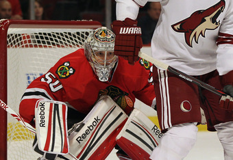 Crawford looks to stop the Coyotes fast-paced offense from scoring.
