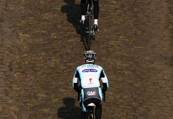 WALLERS, FRANCE - APRIL 06:  Two Omega Pharma-Quick Step riders make their way over the cobbles of the Arenberg Forest during training for the 2012 Paris - Roubaix Cycle Race on April 6, 2012 in Wallers, France.  (Photo by Bryn Lennon/Getty Images)