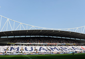 Bolton fans unite to show their support for Muamba at the Reebok Stadium before a Premier League fixture