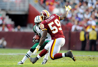 LANDOVER, MD - DECEMBER 04:  Jeremy Kerley #11 of the New York Jets avoids a tackle by London Fletcher #59 of the Washington Redskins during a game at FedExField on December 4, 2011 in Landover, Maryland.  (Photo by Patrick McDermott/Getty Images)