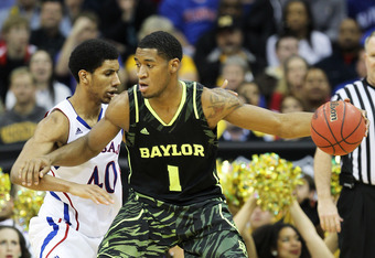 KANSAS CITY, MO - MARCH 09:  Perry Jones III #1 of the Baylor Bears drives against Kevin Young #40 of the Kansas Jayhawks in the second half during the semifinals of the 2012 Big 12 Men's Basketball Tournament at Sprint Center on March 9, 2012 in Kansas C