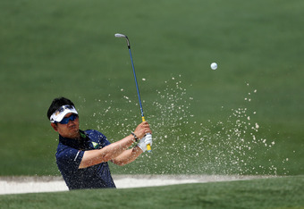 AUGUSTA, GA - APRIL 07:  Y.E. Yang of Korea hits a shot out of the bunker on the second hole during the third round of the 2012 Masters Tournament at Augusta National Golf Club on April 7, 2012 in Augusta, Georgia.  (Photo by Andrew Redington/Getty Images