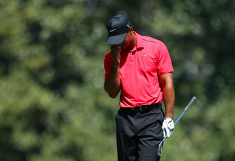 AUGUSTA, GA - APRIL 08:  Tiger Woods of the United States reacts after an approach shot on the fifth hole during the final round of the 2012 Masters Tournament at Augusta National Golf Club on April 8, 2012 in Augusta, Georgia.  (Photo by Andrew Redington