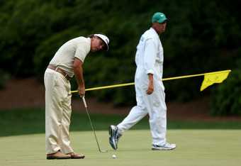 AUGUSTA, GA - APRIL 08:  Phil Mickelson of the United States putts on the 13th hole as caddie Jim Mackay looks on during the final round of the 2012 Masters Tournament at Augusta National Golf Club on April 8, 2012 in Augusta, Georgia.  (Photo by Andrew R