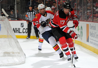 NEWARK, NJ - FEBRUARY 11:  Ilya Kovalchuk #17 of the New Jersey Devils is challenged for the puck by Tyson Strachan #23 of the Florida Panthers during the game on February 11, 2012 at the Prudential Center in Newark, New Jersey. (Photo by Christopher Pasa