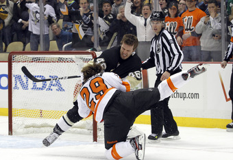 PITTSBURGH, PA - APRIL 7:  Joe Vitale #46 of the Pittsburgh Penguins mixes it up with Harry Zolnierczyk #29 of the Philadelphia Flyers during the game at Consol Energy Center on April 7, 2012 in Pittsburgh, Pennsylvania.  (Photo by Justin K. Aller/Getty I