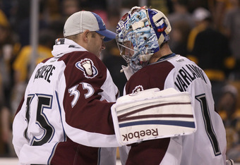 BOSTON, MA - OCTOBER 10:  Semyon Varlamov #1 of the Colorado Avalanche is congratulated by teammate Jean-Sebastien Giguere #35 after Varlamov shut out the Boston Bruins on October 10, 2011 at TD Garden in Boston, Massachusetts. The Colorado Avalanche defe