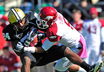 NASHVILLE, TN - OCTOBER 29:  Tramain Thomas #5 of the Arkansas Razorbacks tackles Wesley Tate #24 of the Vanderbilt Commodores during play at Vanderbilt Stadium on October 29, 2011 in Nashville, Tennessee.  (Photo by Grant Halverson/Getty Images)
