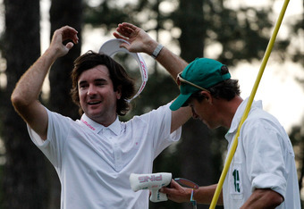 AUGUSTA, GA - APRIL 08:  Bubba Watson (L) of the United States celebrates with his caddie Ted Scott after  winning his sudden death playoff on the second playoff hole to win the 2012 Masters Tournament by one stroke at Augusta National Golf Club on April