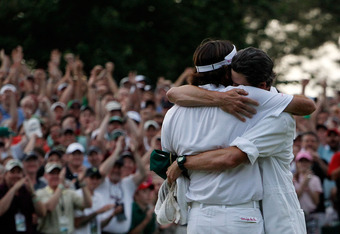 AUGUSTA, GA - APRIL 08:  Bubba Watson (L) of the United States celebrates with his caddie Ted Scott after winning his sudden death playoff on the second playoff hole to win the 2012 Masters Tournament by one stroke at Augusta National Golf Club on April 8