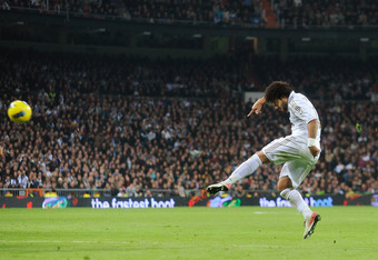MADRID, SPAIN - NOVEMBER 26: Marcelo of Real Madrid has a shot at goal during the La Liga match between Real Madrid and Atletico Madrid at Estadio Santiago Bernabeu on November 26, 2011 in Madrid, Spain.  (Photo by Denis Doyle/Getty Images)